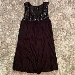Precious little black dress with sparkly top!